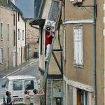 Pushing a fridge up a step ladder