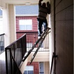 Painting on a precarious ladder